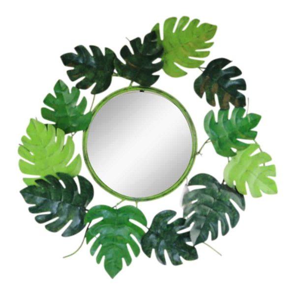 metalen spiegel rond bladeren
